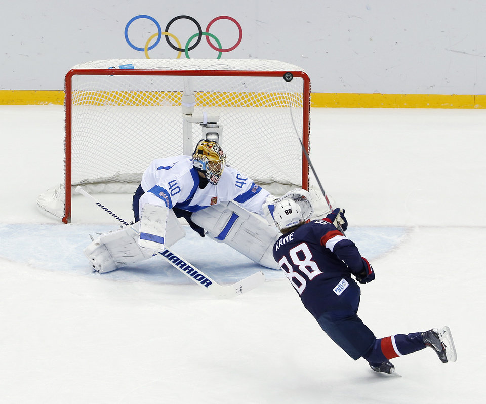 Photo - USA forward Patrick Kane hits the post as he shoots on Finland goaltender Tuukka Rask during the second period of the men's bronze medal ice hockey game at the 2014 Winter Olympics, Saturday, Feb. 22, 2014, in Sochi, Russia. (AP Photo/David J. Phillip  )