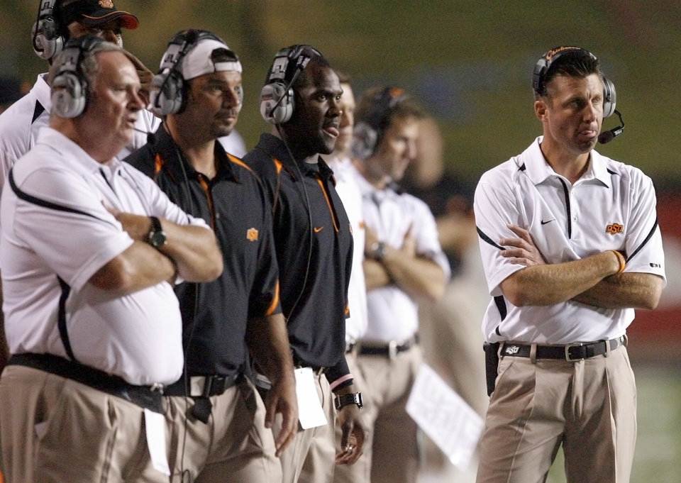 Photo - OSU coach Mike Gundy watches during the football game between the University of Louisiana-Lafayette and Oklahoma State University at Cajun Field in Lafayette, La., Friday, October 8, 2010. Photo by Bryan Terry, The Oklahoman