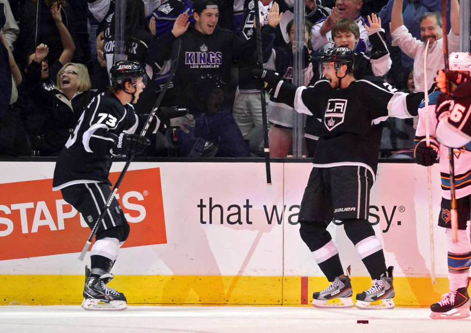 Photo - Los Angeles Kings center Trevor Lewis, right, celebrates his goal with center Tyler Toffoli during the third period in Game 2 of their second-round NHL hockey Stanley Cup playoff series against the San Jose Sharks, Thursday, May 16, 2013, in Los Angeles.  (AP Photo/Mark J. Terrill)