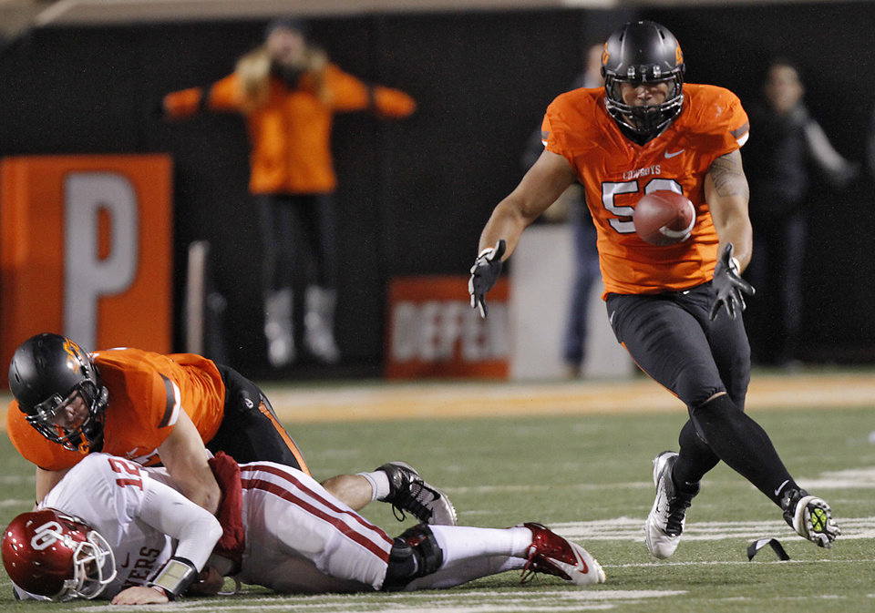 Oklahoma State\'s Alex Elkins (37) sacks Landry Jones (12) to cause a fumble recovered by Oklahoma State\'s Jamie Blatnick (50) during the Bedlam college football game between the Oklahoma State University Cowboys (OSU) and the University of Oklahoma Sooners (OU) at Boone Pickens Stadium in Stillwater, Okla., Saturday, Dec. 3, 2011. Photo by Chris Landsberger, The Oklahoman