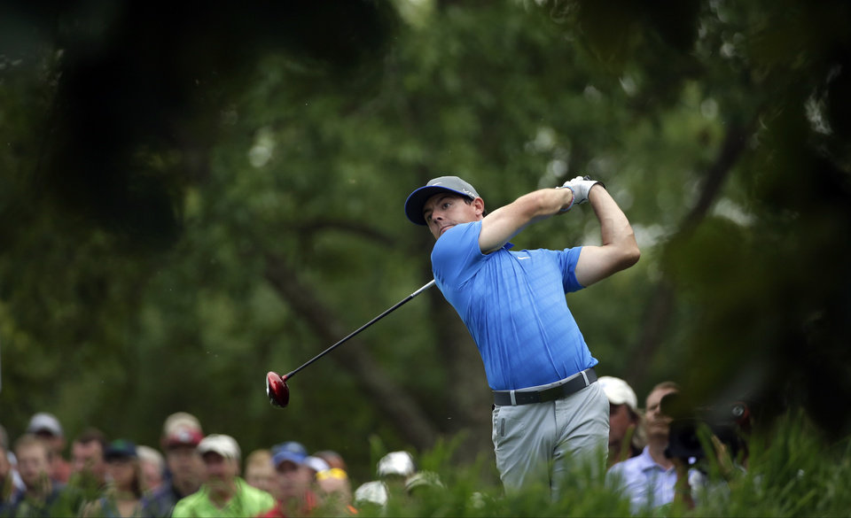 Photo - Rory McIlroy, of Northern Ireland, watches his tee shot on the 18th hole during the third round of the PGA Championship golf tournament at Valhalla Golf Club on Saturday, Aug. 9, 2014, in Louisville, Ky. (AP Photo/David J. Phillip)