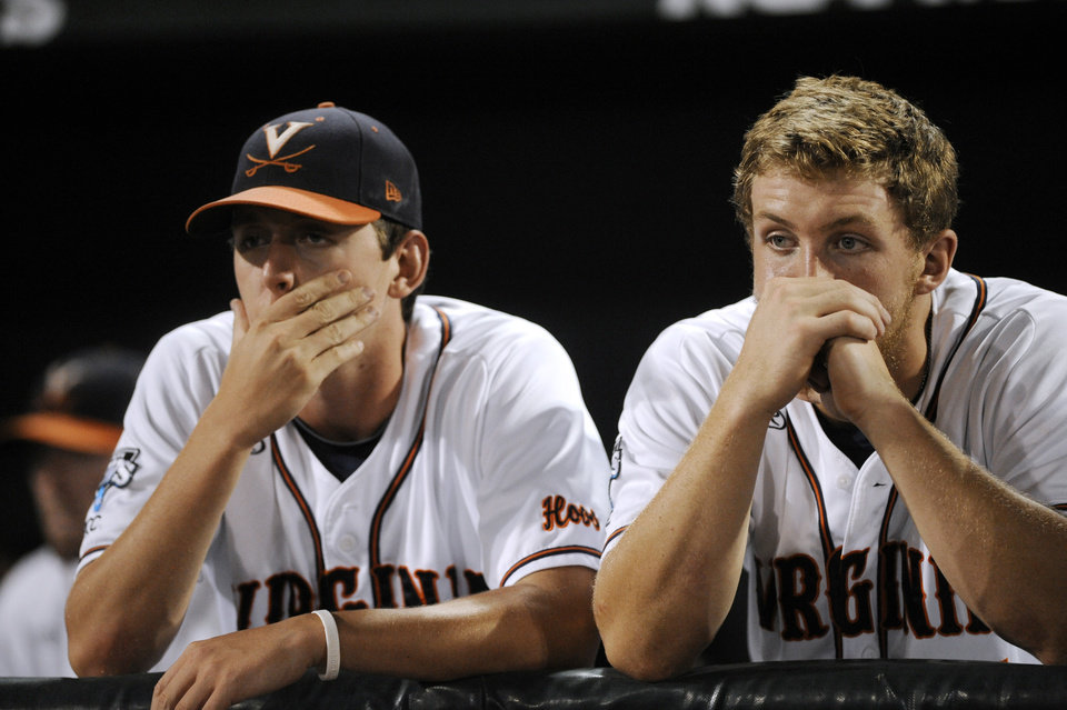 Photo - Virginia players react to a 3-2 loss to Vanderbilt in the deciding game of the best-of-three NCAA baseball College World Series finals in Omaha, Neb., Wednesday, June 25, 2014. (AP Photo/Eric Francis)