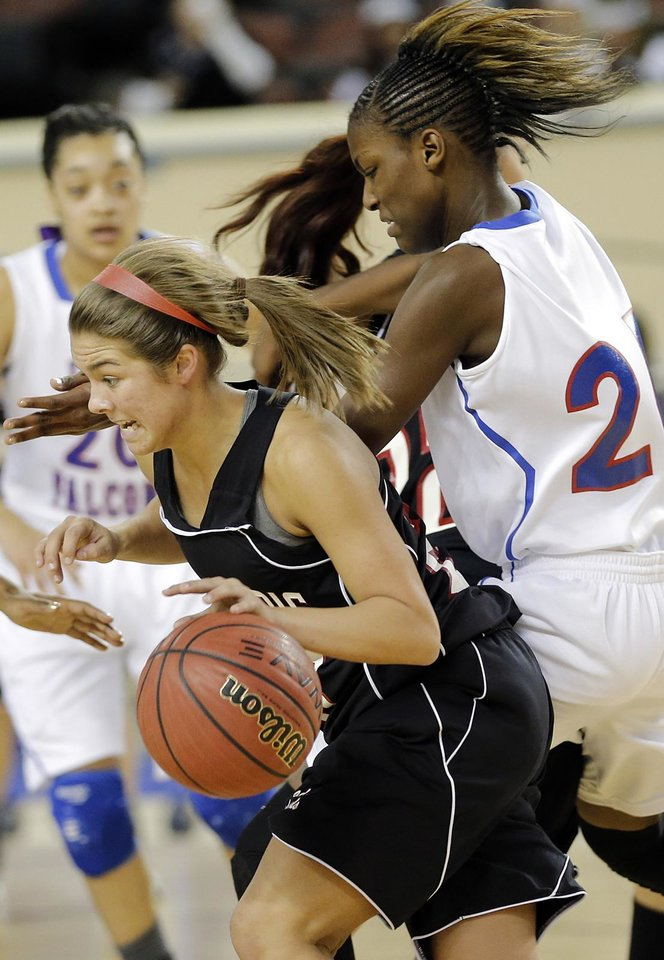 Photo - Verdigris' Baileigh O'Dell (25) drives past Millwood's Raven Prince (24) during the 3A girls quarterfinals game between Millwood High School and Verdigris High School at the State Fair Arena on Thursday, March 7, 2013, in Oklahoma City, Okla. Photo by Chris Landsberger, The Oklahoman