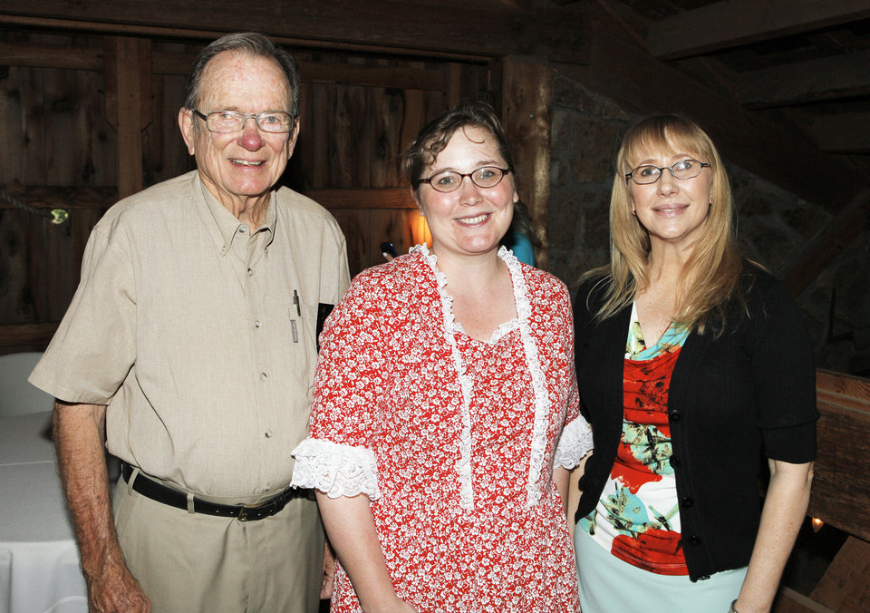 Photo - Dick Workman, Okla. City, Melessa Gregg (CQ MELLESSA), Harn Homestead executive director, and Shelley Sanders, Harn Homestead treasurer, attending a brunch held in one of the barns at the Harn Homestead in Oklahoma City Friday, April 27, 2012.  Photo by Paul B. Southerland, The Oklahoman