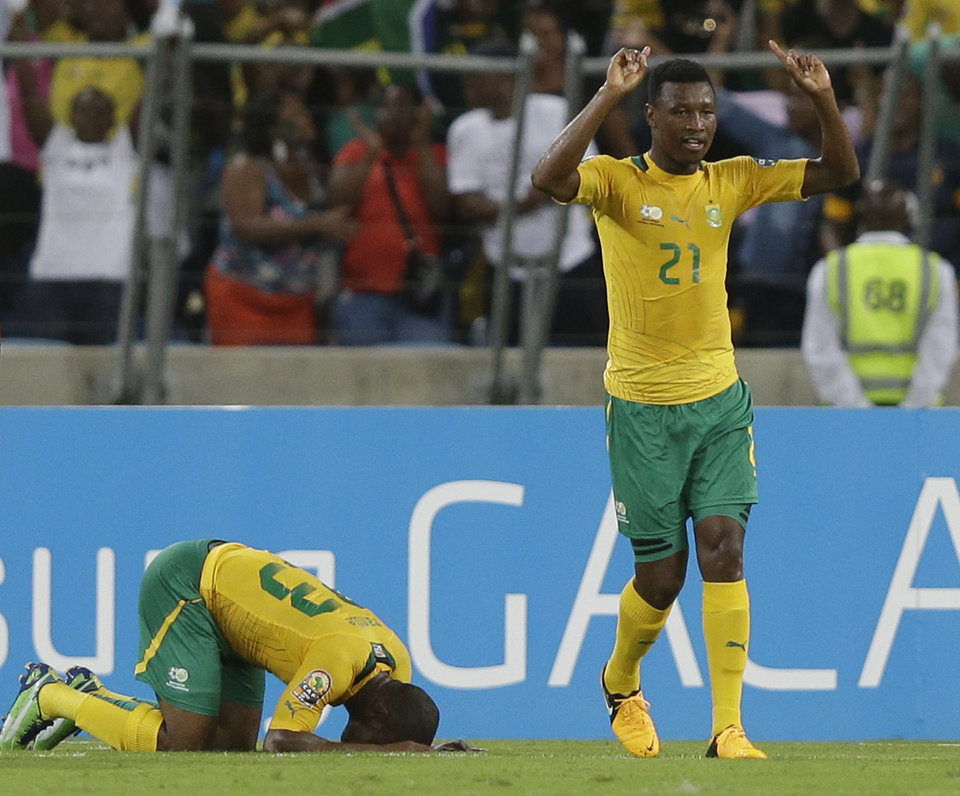 Photo - South Africa's Siyabonga Sangweni, right, and Tokelo Rantie celebrate Rantie's goal against Mali in their African Cup of Nations quarterfinal soccer match against Mali, at Moses Mabhida Stadium in Durban, South Africa, Saturday, Feb. 2, 2013. (AP Photo/Rebecca Blackwell)