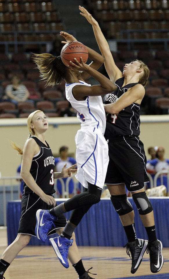 Verdigris' Courtney Risenhoover (14) defends on Millwood's Raven Prince (24) during the 3A girls quarterfinals game between Millwood High School and Verdigris High School at the State Fair Arena on Thursday, March 7, 2013, in Oklahoma City, Okla. Photo by Chris Landsberger, The Oklahoman