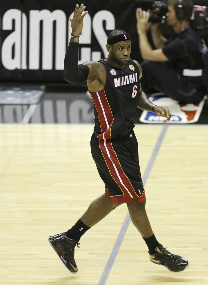 Photo - Miami Heat's LeBron James (6) reacts after scoring against the San Antonio Spurs during the first half at Game 4 of the NBA Finals basketball series, Thursday, June 13, 2013, in San Antonio. (AP Photo/David J. Phillip)