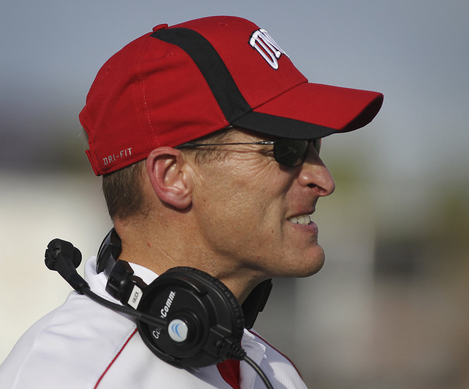 Photo -   UNLV head coach Bobby Hauck reacts after a Wyoming touchdown during an NCAA college football game in Las Vegas, Saturday, Nov. 17, 2012. (AP Photo/Las Vegas Review-Journal, Jason Bean) LAS VEGAS SUN OUT; LOCAL TV OUT; LOCAL INTERNET OUT