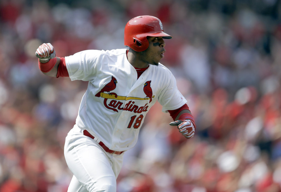 Photo - St. Louis Cardinals' Oscar Taveras pumps his fist as he runs down the first base line after hitting an RBI single during the seventh inning of a baseball game against the Milwaukee Brewers Sunday, Aug. 3, 2014, in St. Louis. (AP Photo/Jeff Roberson)
