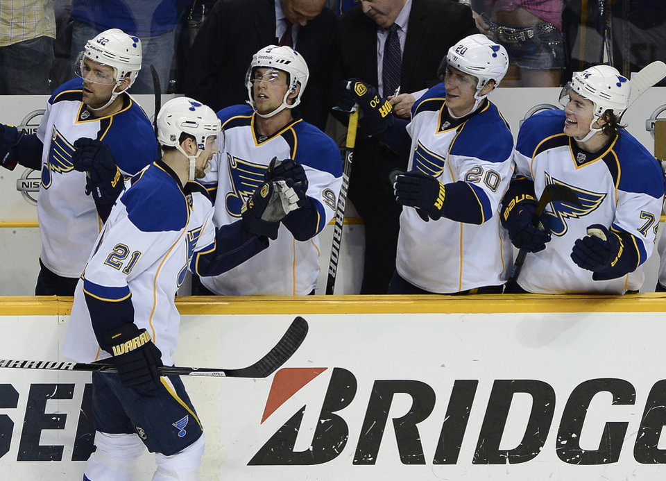 Photo - St. Louis Blues center Patrik Berglund (21), of Sweden, is congratulated after scoring in the first period of an NHL hockey game against the Nashville Predators, Saturday, March 15, 2014, in Nashville, Tenn. (AP Photo/Mark Zaleski)