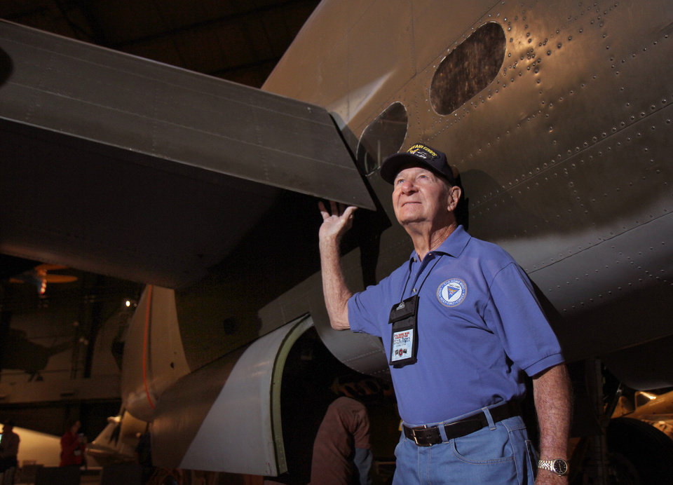 Photo - In this Sept 27, 2013 photo, Bernie Peters touches the wing of a B-25 bomber as he talks about his World War II experiences during a reunion of the 57th Bomb Wing in the U.S. Air Force Museum at Wright Patterson Air Force base in Dayton, Ohio. The 57th Bomb Wing flew missions over German-held Europe from North Africa and the island of Corsica during most of the war. Only nine veterans made it to this fall's reunion. (AP Photo/Tom Uhlman)