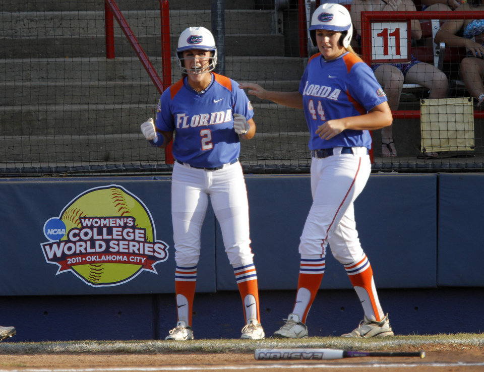 Photo - Florida's Kelsey Bruder (2) a Florida's Brittany Schutte (44) cheer during the Women's College World Series game between Florida and Alabama at the ASA Hall of Fame Stadium in Oklahoma City, Sunday, June 5, 2011. Photo by Sarah Phipps, The Oklahoman