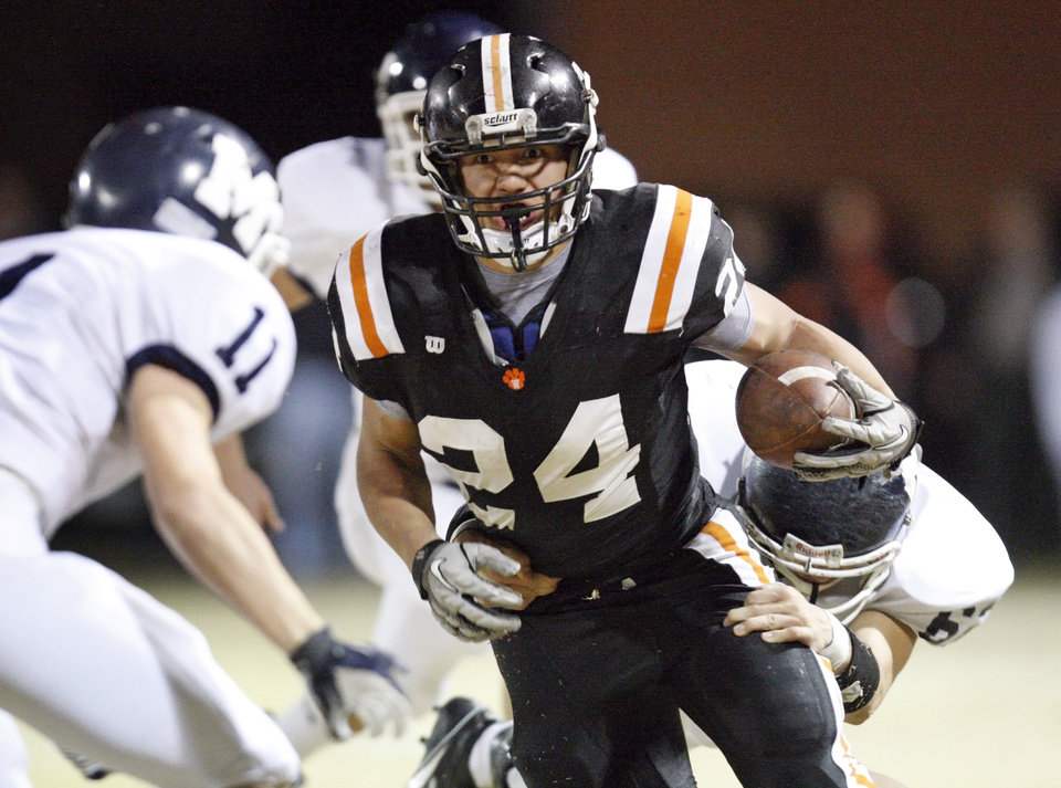 Photo - Josh Way (24) carries the ball for Wayne during a high school football playoff game between Wayne and Minco in Wayne, Okla., Friday, Nov. 25, 2011. Photo by Nate Billings, The Oklahoman