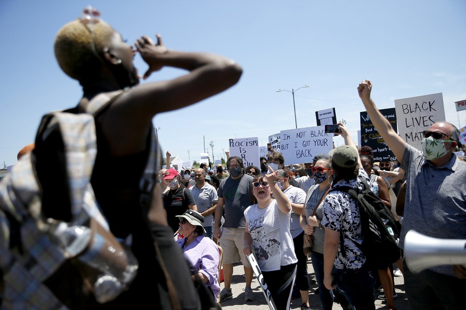 Photo - Protesters chant in a parking lot near NE 36 and Kelley in Oklahoma City on Sunday, May 31, 2020. The Black Lives Matter protest was in response to the death of George Floyd. [Bryan Terry/The Oklahoman]
