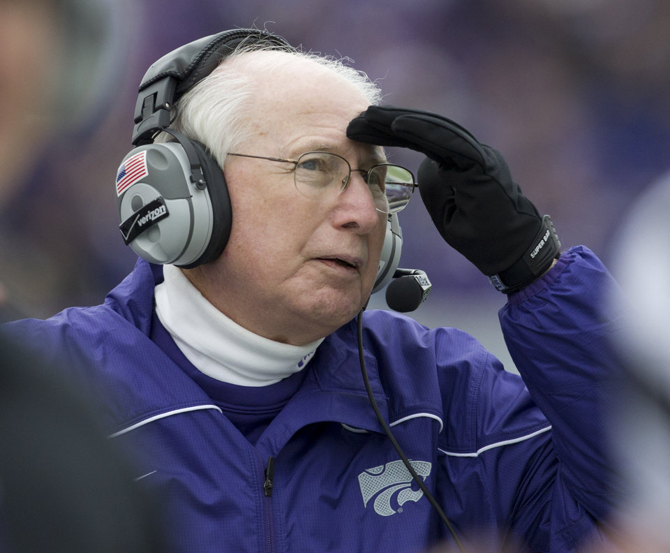 Kansas State coach Bill Snyder watches a replay on the scoreboard during the second half of an NCAA college football game against Kansas in Manhattan, Kan., Saturday, Oct. 6, 2012. (AP Photo/Orlin Wagner)