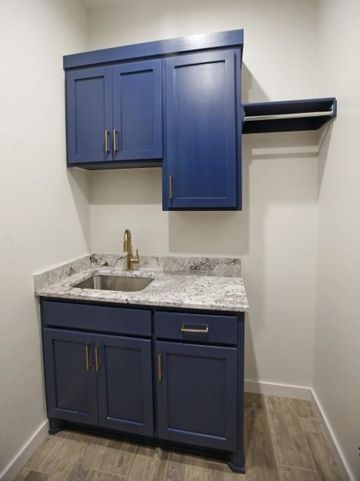 Photo -  Laundry room sink and cabinets at 2215 Kimball Drive, Norman, the featured show home for the Festival of Homes. [BRYAN TERRY/THE OKLAHOMAN]