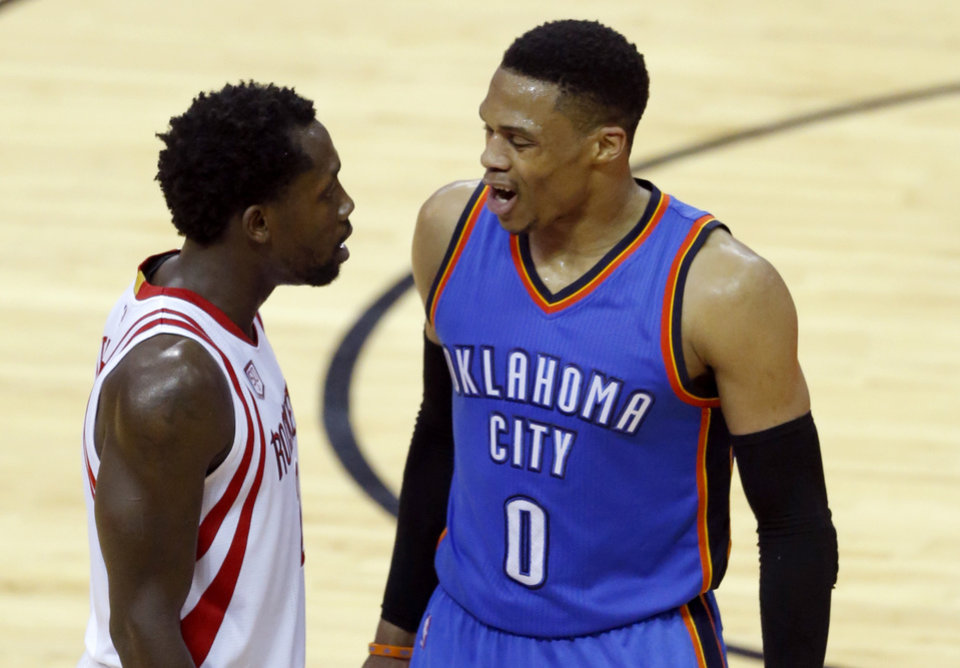 Photo - Oklahoma City's Russell Westbrook (0) and Houston's Patrick Beverley (2) argue during Game 5 in the first round of the NBA playoffs between the Oklahoma City Thunder and the Houston Rockets in Houston, Texas,  Tuesday, April 25, 2017.  Houston won 105-99. Photo by Sarah Phipps, The Oklahoman