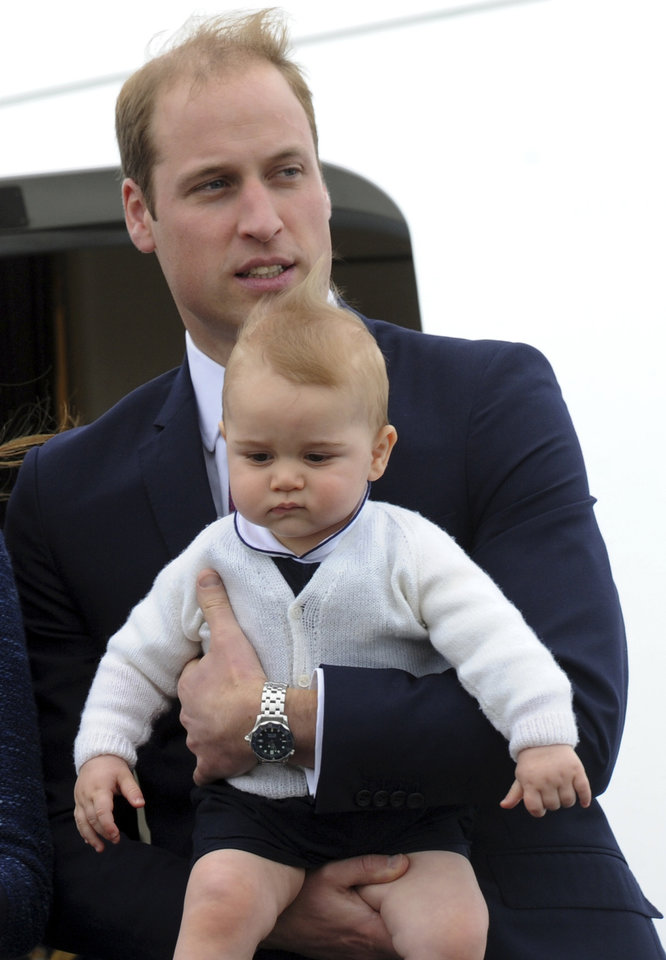 Britain's Prince William carries his son Prince George as they depart for Sydney, Australia, from Wellington, New Zealand, Wednesday, April 16, 2014. (AP Photo/SNPA, Ross Setford) NEW ZEALAND OUT