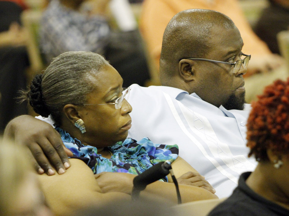 Photo - Carmen Jackson (left) and her husband Jesse Jackson (right) , a former teacher at Marcus Garvey Leadership Academy, react to comments made to the Oklahoma City School Board on May 28, 2013.  Photo by KT King, The Oklahoman
