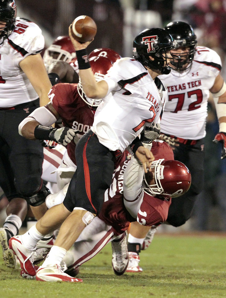 Photo - Oklahoma's Ronnell Lewis (12) causes Texas Tech's Seth Doege (7) to throw the ball away getting a grounding penalty during the first half of the college football game between the University of Oklahoma Sooners (OU) and Texas Tech University Red Raiders (TTU) at the Gaylord Family-Memorial Stadium on Saturday, Oct. 22, 2011. in Norman, Okla. Photo by Steve Sisney, The Oklahoman