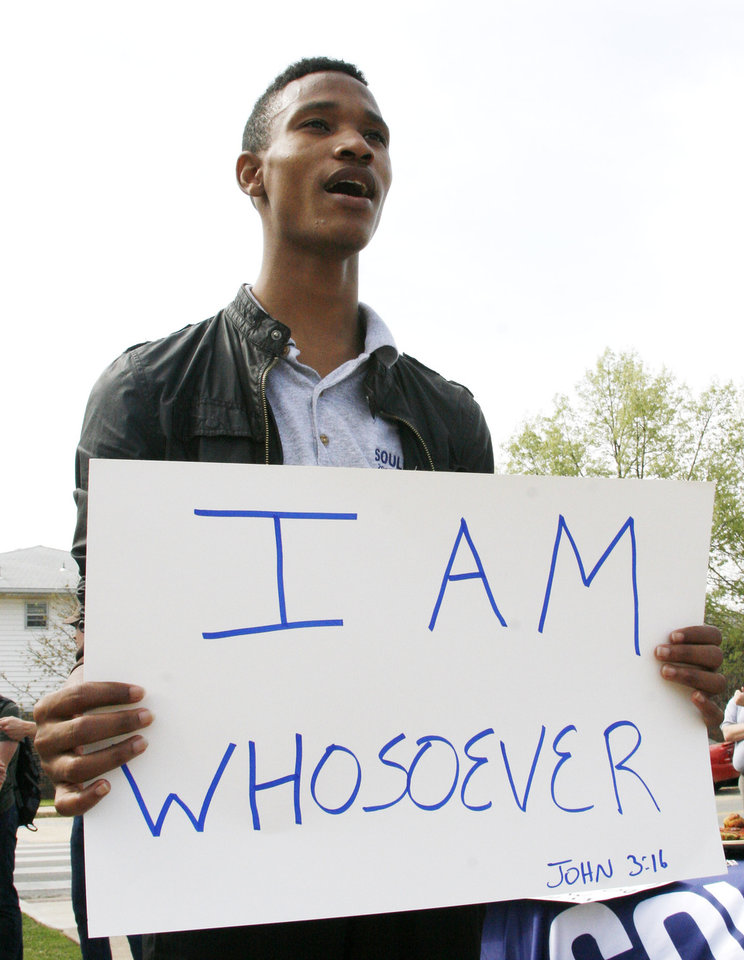 Ibrahim Vicks holds a sign while chanting during the Equality Ride hosted by Soulforce on the campus of Oklahoma Baptist University in Shawnee Wednesday March 28, 2012. Photo by Silas Allen, The Oklahoman