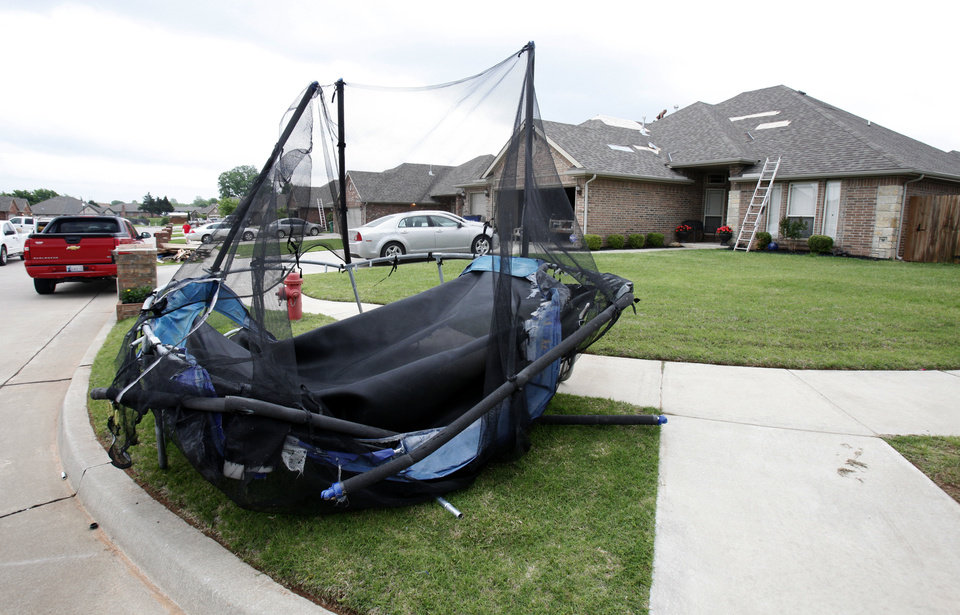 Photo - A number of homes in The Branches neighborhood of Mustang were damaged after a small tornado touched down early Saturday.  PAUL HELLSTERN - Oklahoman