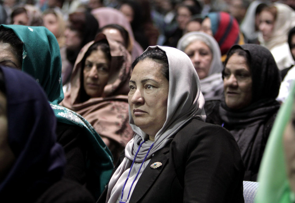 Photo - Members of the Afghan Loya Jirga attend a meeting in Kabul, Afghanistan, Thursday, Nov. 21, 2013. Afghan President Hamid Karzai has told a gathering of elders that he supports signing a security deal with the United States if safety and security conditions are met. Karzai spoke as the 2,500-member national consultative council of Afghan elders known as the Loya Jirga started in Kabul on Thursday. The four-day meeting will discuss the bilateral security pact that defines the role of thousands of U.S. troops who will remain after the NATO combat mission ends in 2014. (AP Photo/Rahmat Gul)