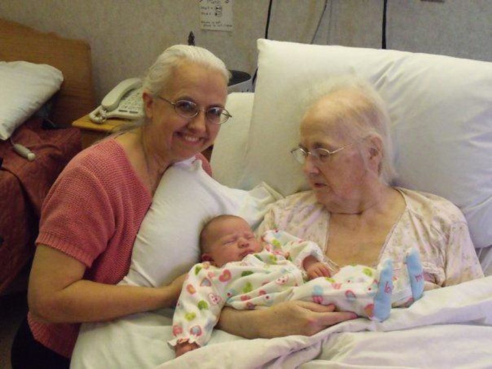 Sally White, left, visits her mother, the late Sara Carpenter, who holds her great niece Elizabeth White. Photo provided. <strong></strong>