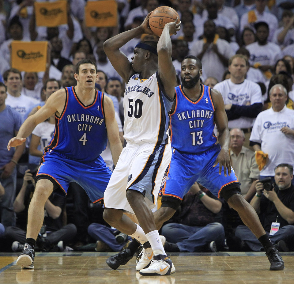 Photo - Memphis Grizzlies forward Zach Randolph (50) is defended by Oklahoma City Thunder forward Nick Collison (4) and James Harden (13) during the overtime period of Game 3 in a second-round NBA basketball series on Saturday, May 7, 2011, in Memphis, Tenn. Randolph led the Grizzlies with 21 points as they won 101-93 in overtime to take a 2-1 lead in the series. (AP Photo/Mark Humphrey)