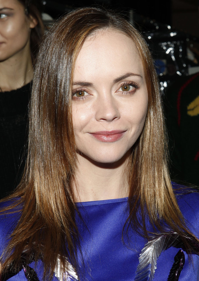 Photo - Actress Christina Ricci attends the Richard Chai Fall 2013 fashion show during Mercedes-Benz Fashion Week at The Stage at Lincoln Center on Thursday, Feb. 7, 2013 in New York. (Photo by Amy Sussman/Invision/AP)