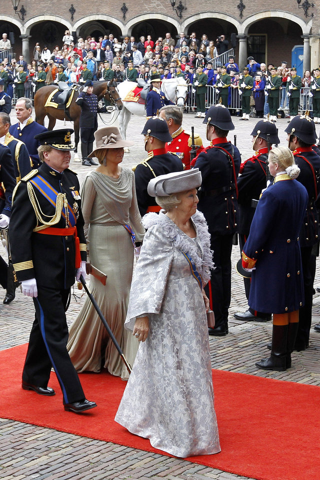 """FILE - In this Sept. 20, 2011 file photo, Dutch Queen Beatrix, center, Crown Prince Willem-Alexander, left and Princess Maxima, second left, arrive at the """"Hall of Knights"""" to formally open the new parliamentary year in The Hague, Netherlands. Queen Beatrix announced she is to abdicate in favor of Crown Prince Willem Alexander during a nationally televised speech Monday, Jan. 28, 2013. Beatrix, who turns 75 on Thursday, has ruled the nation of 16 million for more than 32 years and would be succeeded by her eldest son, Crown Prince Willem-Alexander. (AP Photo/Bas Czerwinski, File)"""