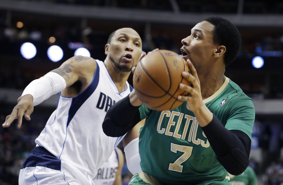 Photo - Boston Celtics center Jared Sullinger (7) is defended by Dallas Mavericks forward Shawn Marion (0) during the first half an NBA basketball game Monday, March 17, 2014, in Dallas. (AP Photo/LM Otero)