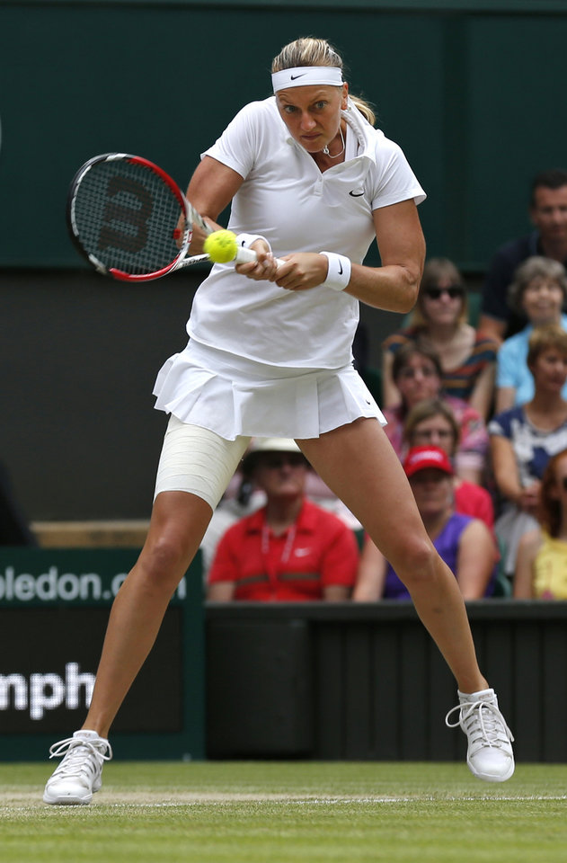 Photo - Petra Kvitova of the Czech Republic plays a return against Eugenie Bouchard of Canada during the women's singles final at the All England Lawn Tennis Championships in Wimbledon, London, Saturday, July 5, 2014. (AP Photo/Sang Tan)