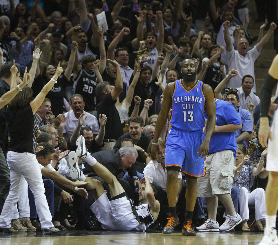 Photo - The crowd reacts behind Oklahoma City's James Harden (13) after San Antonio's Manu Ginobili (20) made a basket at the end of the first period of Game 1 of the Western Conference Finals between the Oklahoma City Thunder and the San Antonio Spurs in the NBA playoffs at the AT&T Center in San Antonio, Texas, Sunday, May 27, 2012. Oklahoma City lost 101-98. Photo by Bryan Terry, The Oklahoman
