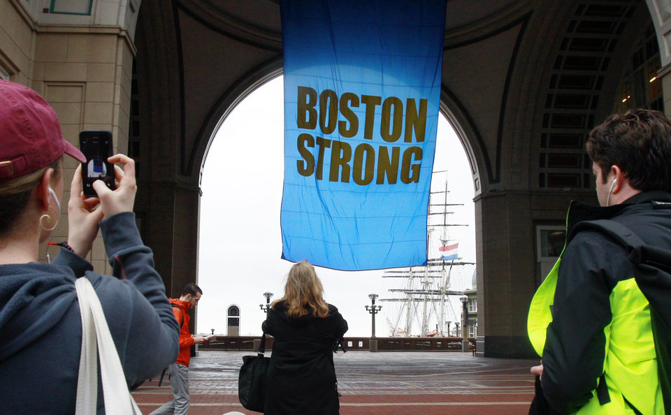 Photo - People photograph a banner reading
