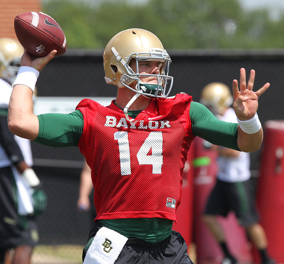 Photo - Baylor quarterback Bryce Petty looks downfield while throwing on the first day of NCAA college football practice, Tuesday, Aug. 5, 2014, in Waco, Texas. (AP Photo/Waco Tribune Herald, Jerry Larson)