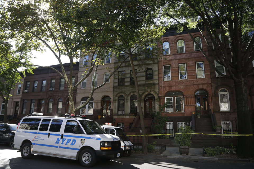 Photo - Police park next to the home of Cathleen Alexis, mother of Navy Yard shooter Aaron Alexis, in Brooklyn, N.Y. Wednesday, Sept. 18, 2013. The mother of the man who killed 12 people at the Washington Navy Yard made a statement that said she is