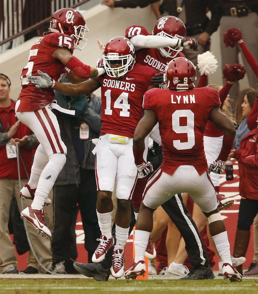 Oklahoma's Aaron Colvin (14) celebrates an interception during a college football game between the University of Oklahoma Sooners (OU) and the Texas Tech Red Raiders at Gaylord Family-Oklahoma Memorial Stadium in Norman, Okla., on Saturday, Oct. 26, 2013. Photo by Steve Sisney, The Oklahoman