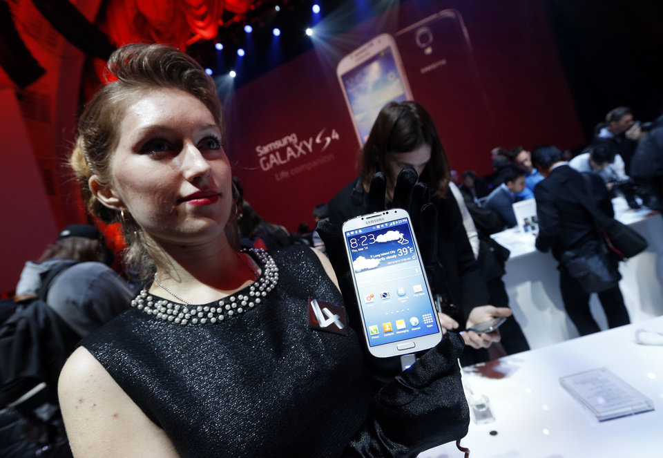 Photo - The new Samsung Galaxy S 4 is presented during the Samsung Unpacked event at Radio City Music Hall, Thursday, March 14, 2013 in New York.  (AP Photo/Jason DeCrow)