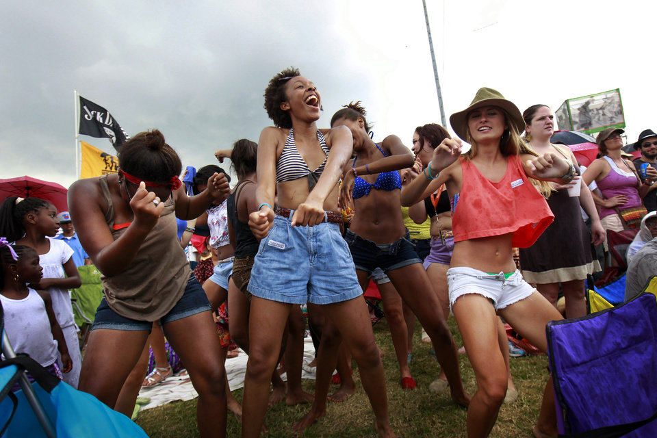 Audience members dance the 'Sissy Bounce' during the 'Bounce Shakedown' at the New Orleans Jazz and Heritage Festival in New Orleans, Sunday, May 6, 2012. The bounce is described by the festival as 'hypersexual dancing and a call-and-response-style party atmosphere.' (AP Photo/Gerald Herbert)