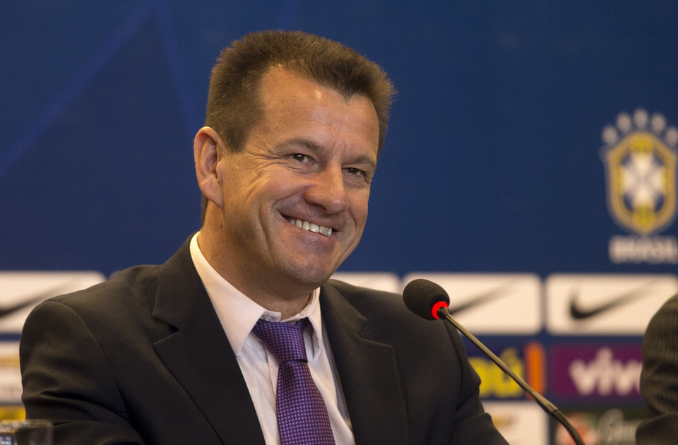 Photo - Brazil's soccer coach Dunga smiles during a press conference in Rio de Janeiro, Brazil, Tuesday, Aug. 19, 2014. Dunga summoned players for the upcoming friendly games against Colombia and Ecuador, the first time he picked players since taking over the national team from Luiz Felipe Scolari after the World Cup. (AP Photo/Silvia Izquierdo)