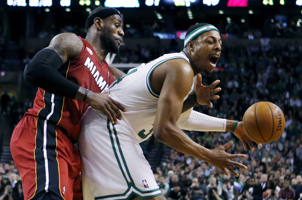 Photo - Miami Heat's LeBron James (6) knocks the ball away from Boston Celtics' Paul Pierce (34) in the second quarter of an NBA basketball game in Boston, Monday, March 18, 2013. (AP Photo/Michael Dwyer)