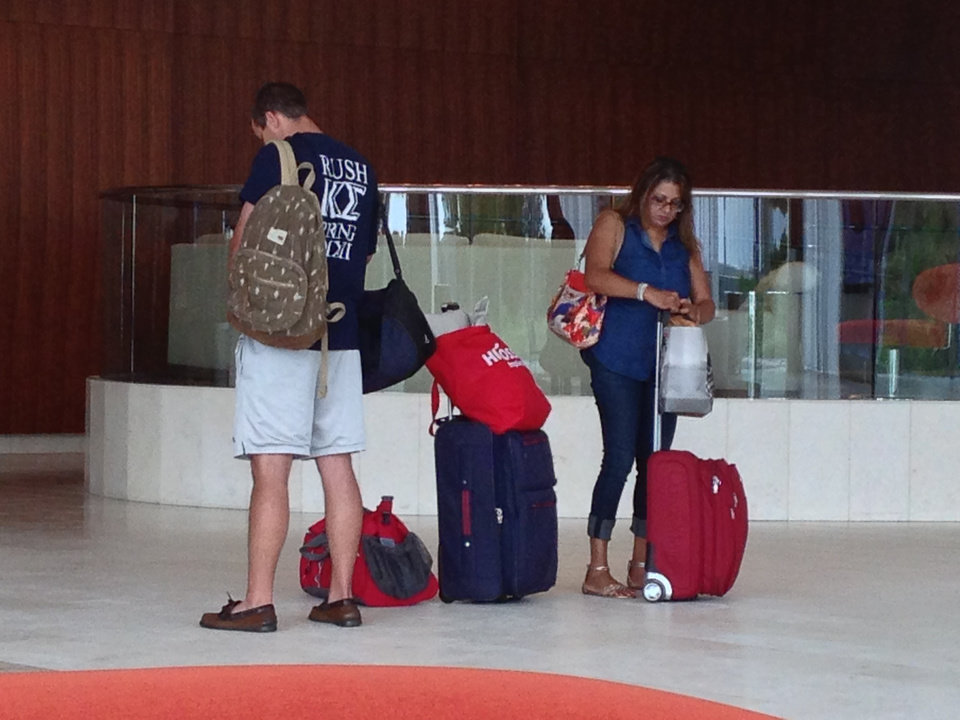 Photo - Hotel guests gather their luggage after checking out of Revel Casino Hotel in Atlantic City N.J. on Monday, Sept. 1, 2014, shortly before it shut down its hotel. The $2.4 billion resort failed after just over two years of operation. It is one of three Atlantic City casinos shutting down over the next two weeks. (AP Photo/Wayne Parry)