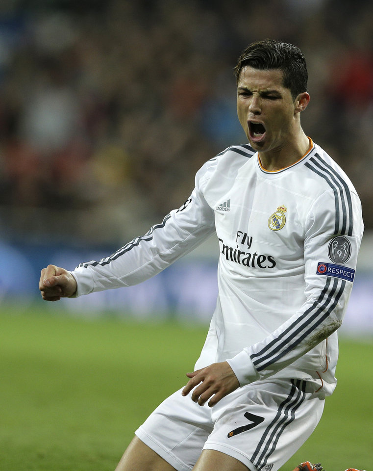 Photo - Real's Cristiano Ronaldo reacts during a Champions League quarterfinal first leg soccer match between Real Madrid and Borussia Dortmund at the Santiago Bernabeu   stadium in Madrid, Spain, Wednesday April 2, 2014. (AP Photo/Paul White)