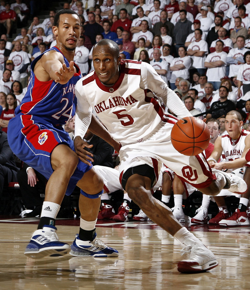 OU's Tony Crocker (5) drives past Travis Releford (24) of KU in the second half of the men's college basketball game between Kansas and Oklahoma at the Lloyd Noble Center in Norman, Okla., Monday, February 23, 2009. KU won, 87-78. BY NATE BILLINGS, THE OKLAHOMAN