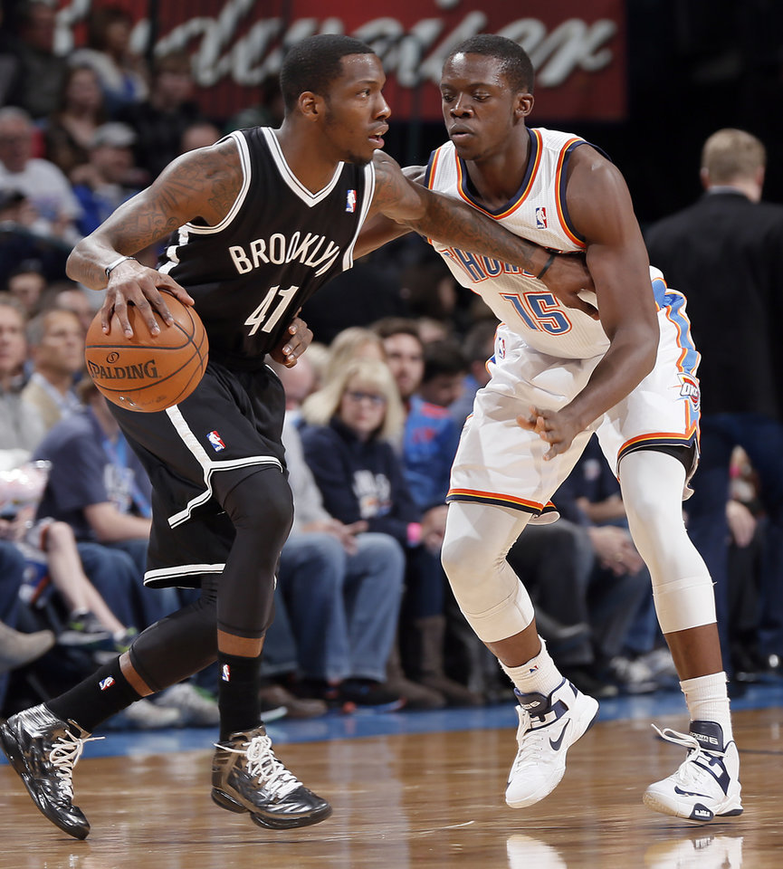 Oklahoma City's Reggie Jackson (15) defends on Brooklyn Nets' Tyshawn Taylor (41) during the NBA basketball game between the Oklahoma City Thunder and the Brooklyn Nets at the Chesapeake Energy Arena on Wednesday, Jan. 2, 2013, in Oklahoma City, Okla. Photo by Chris Landsberger, The Oklahoman