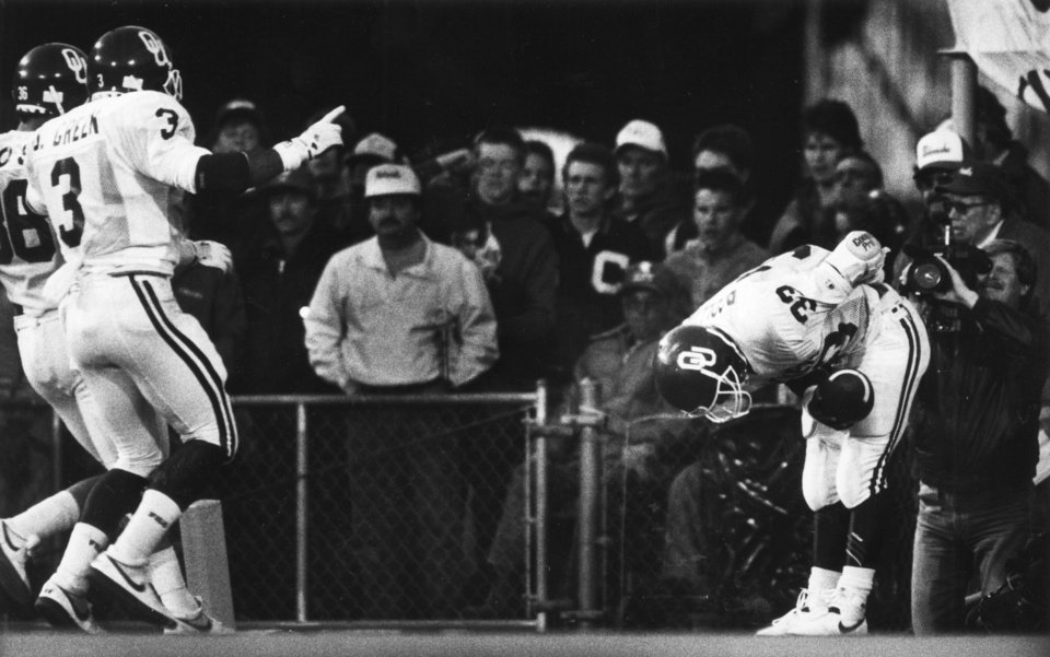 Photo - One of the iconic moments of the series: OU running back Patrick Collins taking a bow after scoring in the 1987 game. THE OKLAHOMAN ARCHIVE