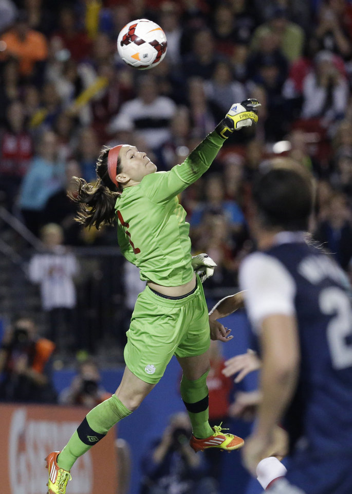Photo - Canada goalkeeper Erin McLeod (1) makes a save during the first half of a soccer game against United States, Friday, Jan. 31, 2014, in Frisco, Texas. (AP Photo/LM Otero)