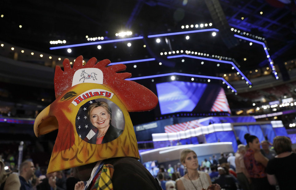 Photo - U.S. Virgin Islands delegate Edgar Phillips wears a rooster head as he walks around the convention floor before the start of the second day session of the Democratic National Convention in Philadelphia, Tuesday, July 26, 2016. (AP Photo/John Locher)