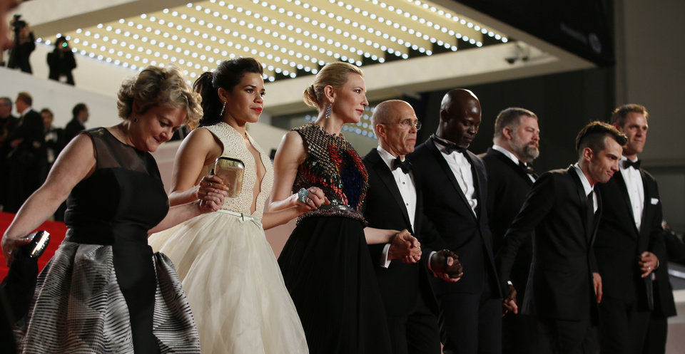 Photo - From left, producer Bonnie Arnold, actress America Ferrera, actress Cate Blanchett, head of Dreamworks Jeffrey Katzenberg, actor Djimon Hounsou,director Dean Deblois and actor Jay Baruchel leave after the screening of Captives at the 67th international film festival, Cannes, southern France, Friday, May 16, 2014. (AP Photo/Alastair Grant)